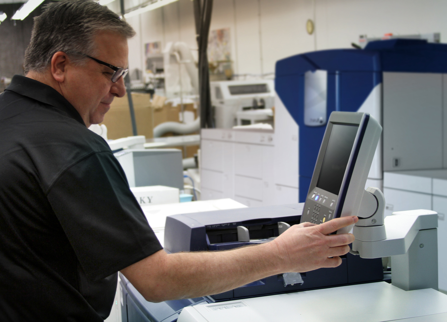 Press Technition working on a Digital Printer